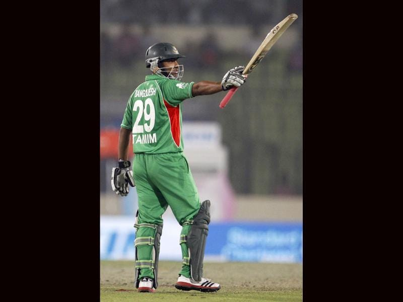 Bangladesh's Tamim Iqbal gestures towards the dressing room after scoring a half century during their Asia Cup cricket match against Pakistan in Dhaka. AP/Aijaz Rahi