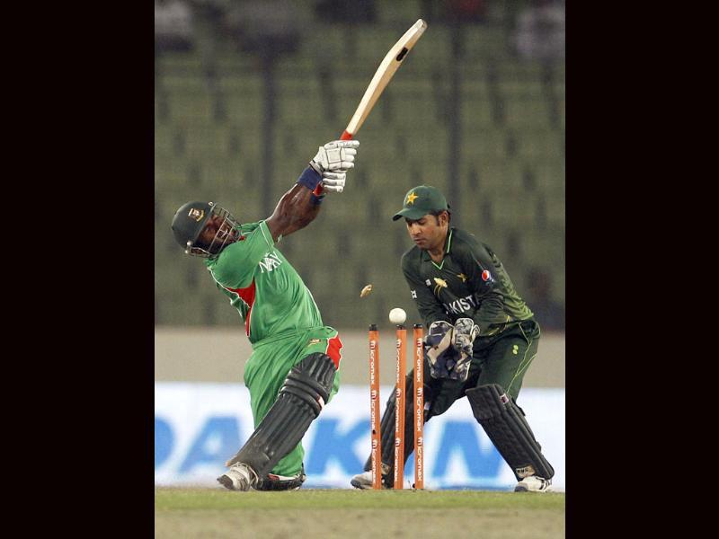 Bangladesh's Jahurul Islam, left, is bowled out by Pakistan's Shahid Afridi during their Asia Cup cricket match in Dhaka, Bangladesh. AP/Aijaz Rahi