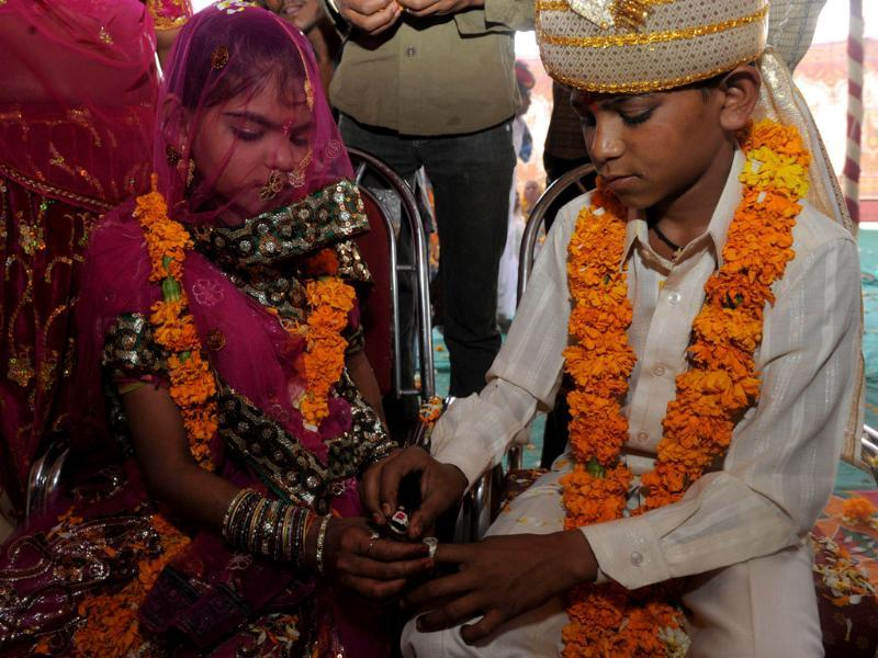 Youth below the legal age of marital consent participate in an engagement ceremony in the village of Vadia, organised by Vicharta Samuday Samarthan Manch, a non-profit group which works with marginalised nomadic communities. AFP/Sam Panthaky