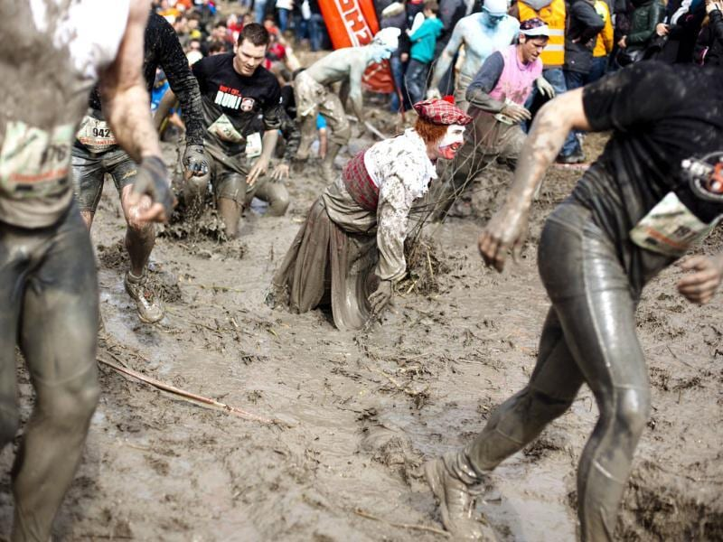 Contestants race through the mud during the Strongman Run competition in Thun. A total of 4,055 competitors took part in the third edition of the race that covers a distance of 16 km (10 miles) and several obstacles. Reuters Photo/Michael Buholzer