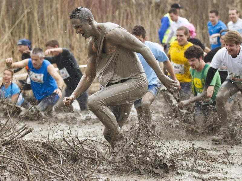 Contestants race through the mud during the Strongman Run competition in Thun. Reuters Photo/Michael Buholzer