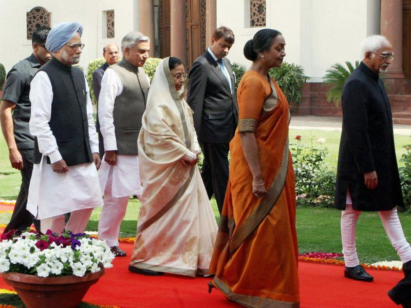 President Pratibha Patil, accompanied by Vice President and Chairman of Rajya Sabha Hamid Ansari, Prime Minister Manmohan Singh, Lok Sabha Speaker Meira Kumar and Parliamentary Affairs Minister Pawan K Bansal, proceeds to address the joint session of Parliament to mark the beginning of Budget session, in New Delhi. PTI Photo by Vijay Kumar Joshi