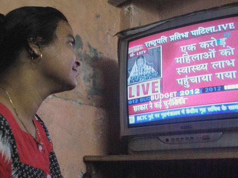 A housewife watching live telecast of President Pratibha Patil's customary address on the opening day of the budget session of Parliament, in Mumbai. The President listed the achievements of the government in providing health benefit facilities for women. Agencies