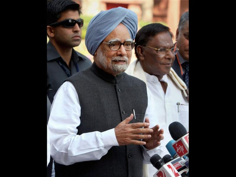 Prime Minister Manmohan Singh with MoS V Narayanasamy talks to the media as he arrives at Parliament House on the first day of the budget session, in New Delhi. PTI Photo by Vijay Kumar Joshi
