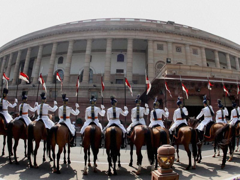Bodyguards of President Pratibha Patil positioned at Parliament House during her address to the joint session of both the Houses on the opening day of the budget session, in New Delhi. PTI Photo by Shahbaz Khan
