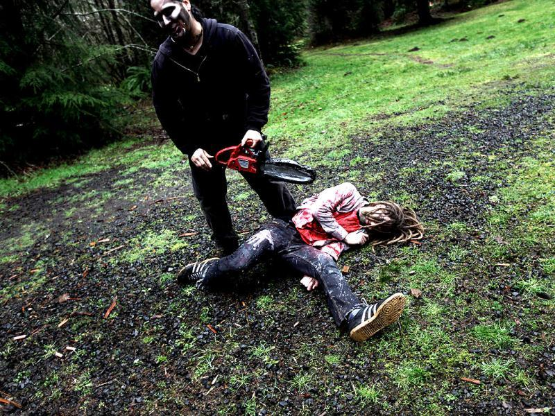 Participants learn how to survive in the wild, including tips on how to make it through a zombie invastion at a