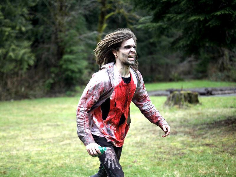 Romain Griffith dressed as a zombie prowls for human flesh at a