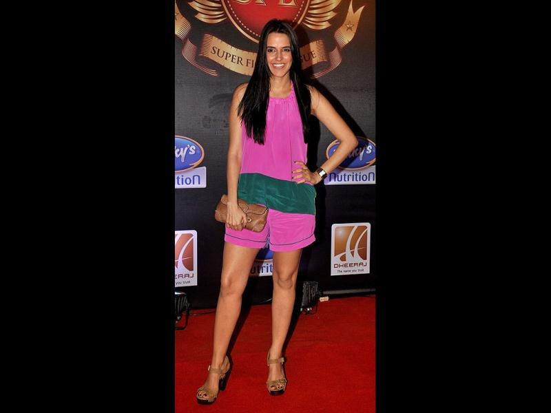 Actor Neha Dhupia in a pink jumpsuit. (AFP Photo)