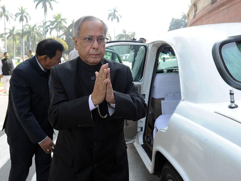 Finance minister Pranab Mukherjee arrives at parliament for the opening of the budget session in New Delhi. AFP PHOTO/ Prakash SINGH