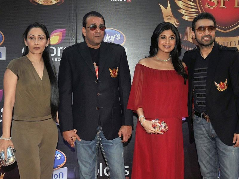 Sanjay Dutt, wife Manyata Dutt, actor Shilpa Shetty and husband Raj Kundra pose as they arrive for the inaugural Super Fight League in Mumbai on March 11. (AFP Photo)