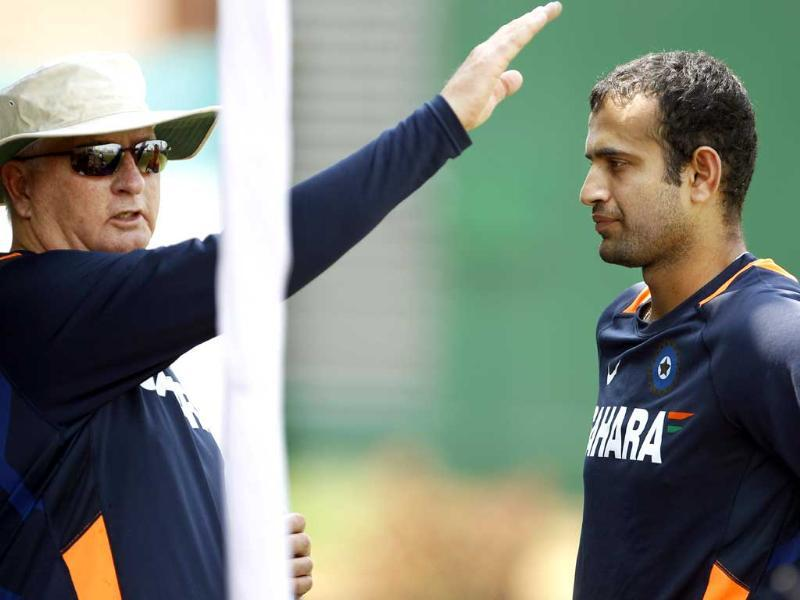Irfan Pathan, right, listens to team coach Duncan Fletcher after a training session in Dhaka, Bangladesh. AP/Aijaz Rahi