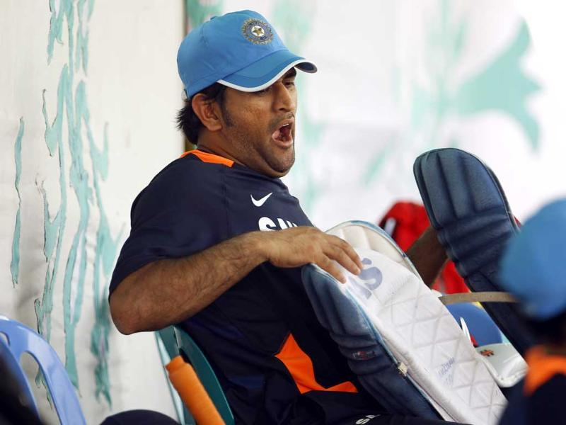 Captain Mahendra Singh Dhoni yawns as he rests after attending a training session in Dhaka, Bangladesh. AP/Aijaz Rahi