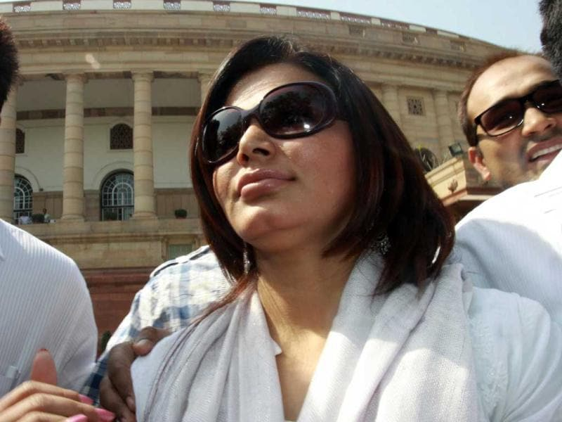 Curious onlookers and scribes jostled with each other to speak to Rakhi Sawant in the Parliament. HT Photo/Sonu Mehta