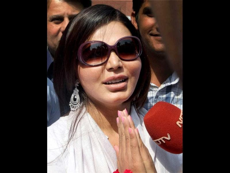 Item girl and actor Rakhi Sawant gestures as she interacts with the media during a visit to Parliament House in New Delhi. PTI Photo/Atul Yadav