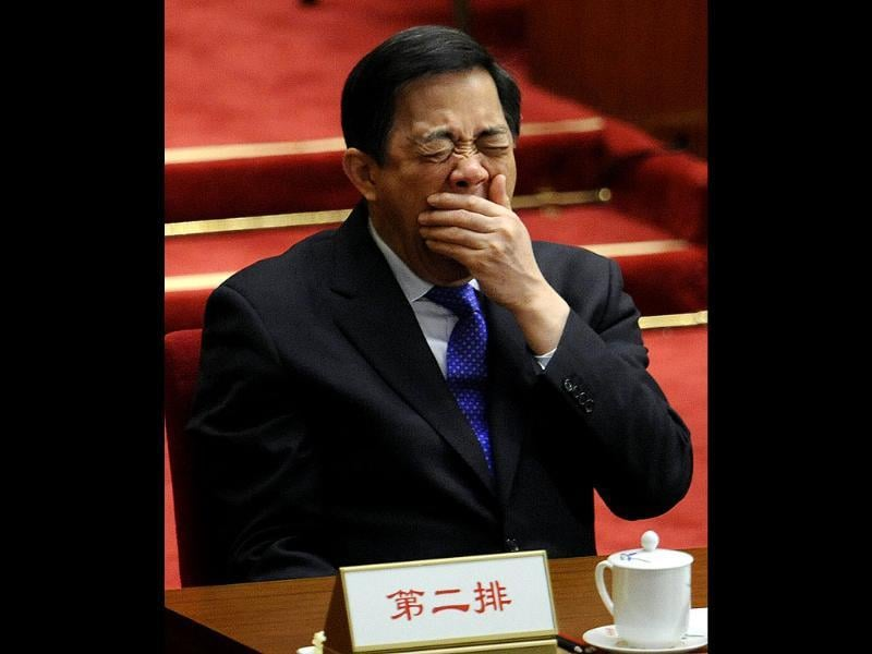 Bo Xilai, Communist Party secretary of Chongqing, yawns during the closing session of the National Committee of the Chinese People's Political Consultative Conference at the Great Hall of the People in Beijing. AFP Photo/Liu Jin