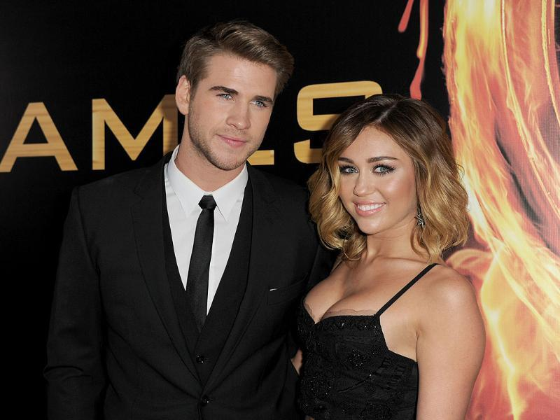 Actor Liam Hemsworth (L) and singer Miley Cyrus arrive at the premiere of Lionsgate's The Hunger Games at Nokia Theatre LA Live in Los Angeles, California. AFP Photo