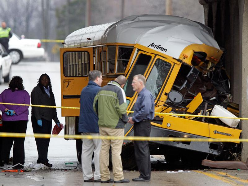 Investigators look over the scene of a fatal bus crash on the southeast side of Indianapolis. AP Photo/Michael Conroy