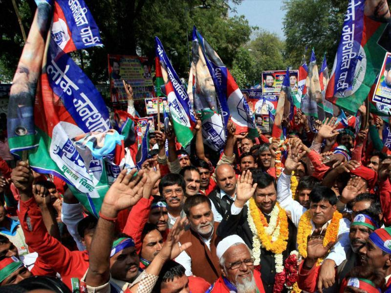 Lok Janshakti Party President Ram Vilas Paswan with members of party's labour cell during a rally to highlight the problems of porters, ahead of presentation of the Railway budget, in New Delhi. (PTI Photo by Shahbaz Khan)