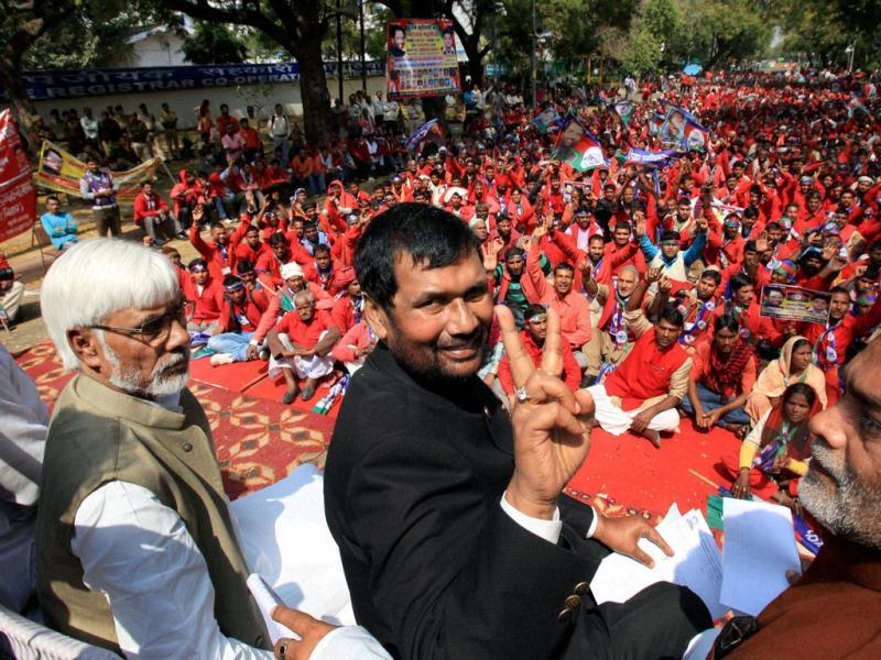 Lok Janshakti Party President Ram Vilas Paswan with RJD's Ram Kripal Yadav (R) and Rajneet Prasad (L) during a rally to highlight the problems of porters, ahead of presentation of the Railway budget, in New Delhi. (PTI Photo by Shahbaz Khan)