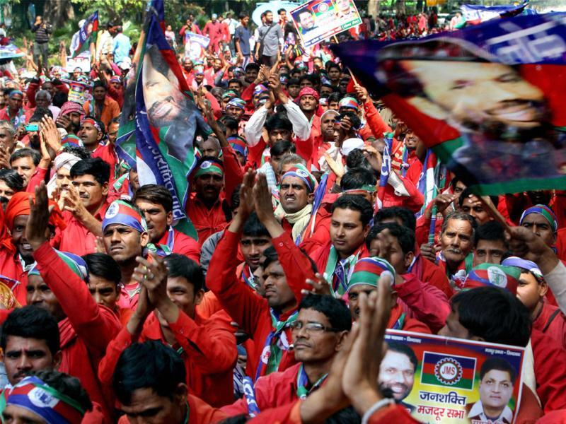Members of Lok Janshakti Party (Labour Cell) shout slogans during a rally to highlight the problems of porters, ahead of presentation of the Railway budget, in New Delhi. (PTI Photo by Shahbaz Khan)