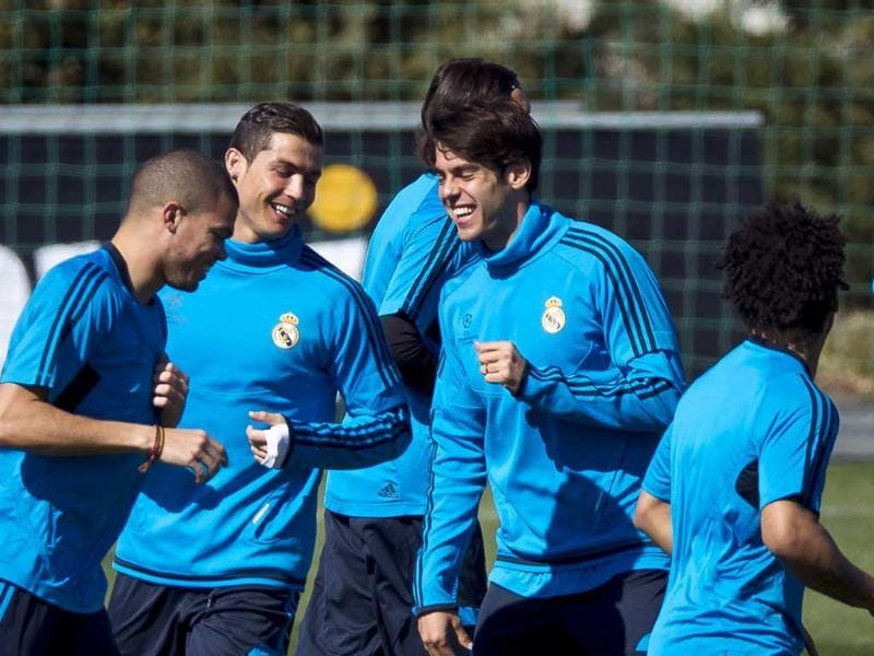 Real Madrid's Pepe from Portugal, left, Cristiano Ronaldo from Portugal, center, and Kaka from Brazil, run and laugh during a training session at the Valdebebas stadium. AP/Daniel Ochoa de Olza