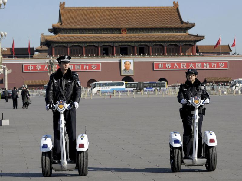 Chinese police patrol Tiananmen Square on their segways during the final session of the National People's Congress (NPC) at the Great Hall of the People in Beijing. AFP Photo/Goh Chai Hin