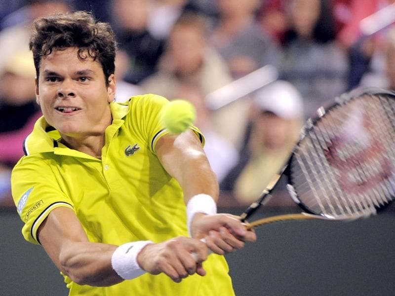 Milos Raonic of Canada returns a shot to Roger Federer of Switzerland at the BNP Paribas Open tennis tournament in Indian Wells, California. AP Photo/Mark J. Terrill