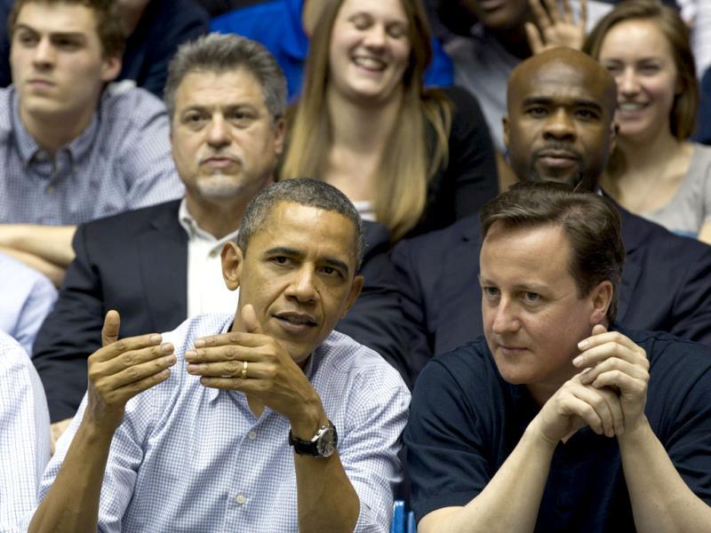 US President Barack Obama and Britain Prime Minister David Cameron attend the Mississippi Valley State versus Western Kentucky first round NCAA tournament basketball game in Dayton, Ohio. AP Photo/Carolyn Kaster