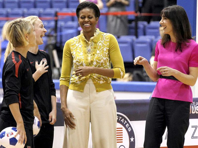 US First lady Michelle Obama and Samantha Cameron, wife of British Primer Minister David Cameron, talk with United States Women's National Soccer Team midfielder Lori Ann Lindsey (L) and defender Becky Sauerbrunn as they join with students participating in a mini-Olympics competition in celebration of the 2012 London Summer Olympics and Mrs. Obama's Let's Move! initiative in Washington. AP Photo/Haraz N. Ghanbari