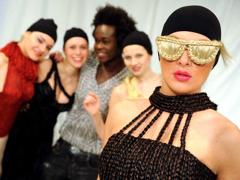 Models present outfits and fake glasses made with artificial hair by German fashion designer Luisa Verfuerth. AFP/Patrik Stollarz