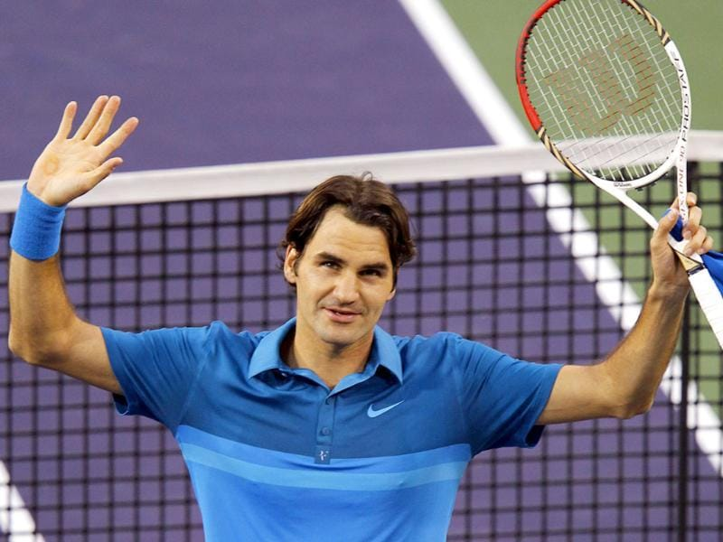 Roger Federer of Switzerland celebrates after defeating Thomaz Bellucci of Brazil following their Men's singles match at the Indian Wells ATP tennis tournament. Reuters/ Mike Blake