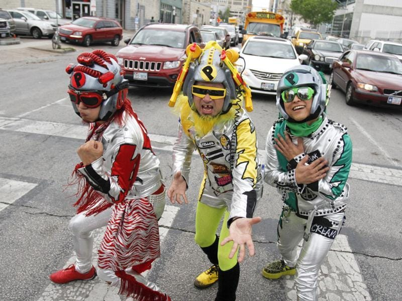 Members of Peelander-Z, from New York via Japan, stop to pose in a crosswalk in downtown Austin, Texas during the SXSW Music Festival. AP Photo/Jack Plunkett