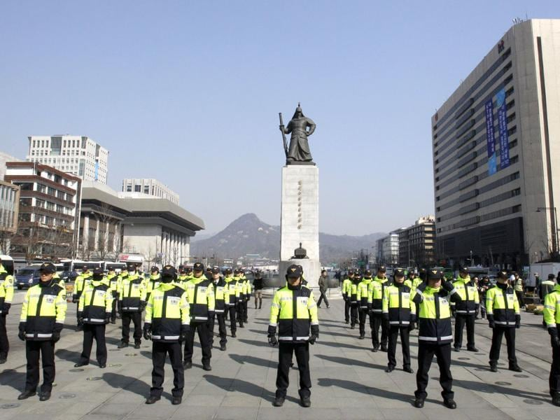 South Korean police officers stand guard during a rally to oppose the free trade agreement, or FTA, with the United States in Seoul, South Korea. AP Photo/Lee Jin-man