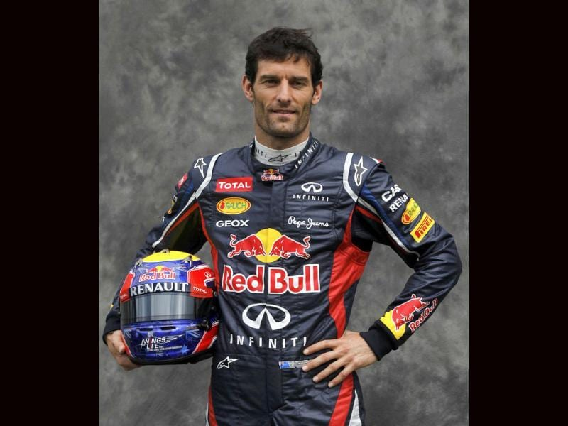 Red Bull Formula One driver Mark Webber of Australia poses prior to the Australian F1 Grand Prix at the Albert Park circuit in Melbourne. Reuters/Daniel Munoz