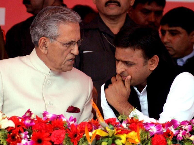Governor of Uttar Pradesh Banwari Lal Joshi and new chief minister of UP Akhilesh Yadav speak during the swearin-in ceremony in Lucknow. The 38-year-old engineering graduate was sworn in as the head of Uttar Pradesh, having bested the heir to the country's leading political dynasty in a watershed election. AFP PHOTO/STR