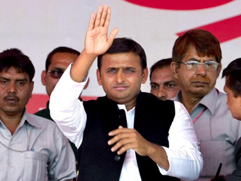 Samajwadi Party (SP) leader Akhilesh Yadav gestures to his supporters during his oath taking ceremony as the chief minister of Uttar Pradesh in Lucknow. Yadav, 38, who played a major role in revival of socialist Samajwadi Party fortunes in the recently concluded state elections, is the youngest chief minister Uttar Pradesh. (AP Photo/Rajesh Kumar Singh)
