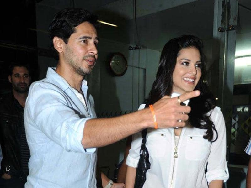 Sunny Leone and Dino Morea at the airport.