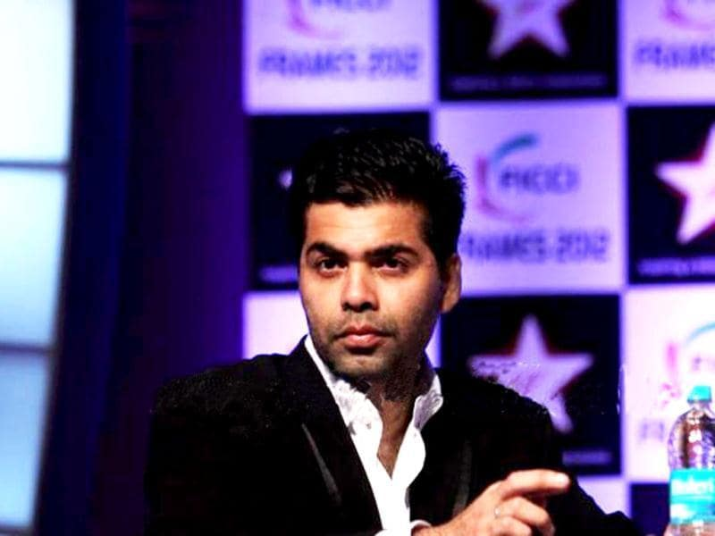 Karan Johar sported a black suit with white shirt.