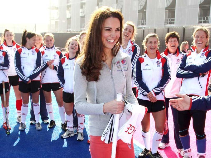 Britain's Catherine, Duchess of Cambridge plays hockey with the GB hockey teams at the Riverside Arena in the Olympic Park in London. Reuters Photo