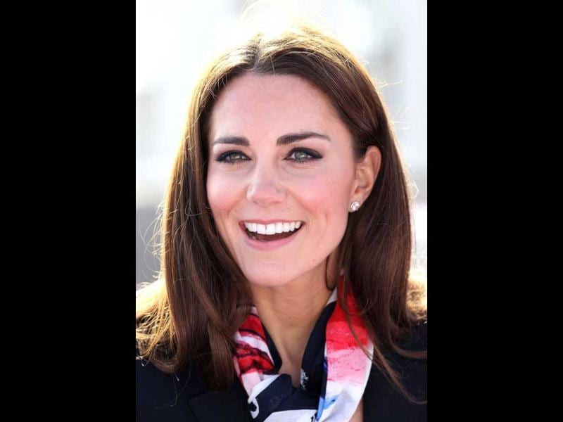 Britain's Catherine, Duchess of Cambridge smiles as she wears the Team GB Official Supporter's Scarf for the London 2012 Olympic Games before meeting the British hockey team at the Riverside Arena during a visit to the Olympic Park in London. AFP Photo