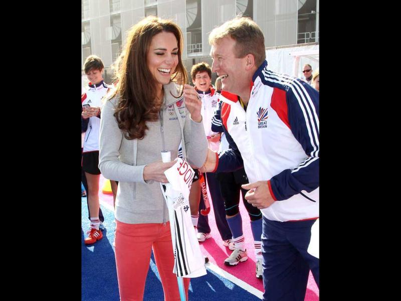 Britain's Catherine, Duchess of Cambridge (L) smiles as she talks with English Hockey Federation performance director David Faulkner (R) at the Riverside Arena during a visit to the Olympic Park in London. AFP Photo