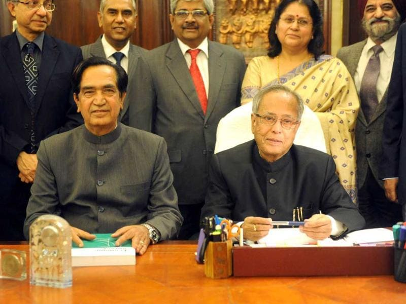 Finance minister Pranab Mukherjee (R) and MoS for finance Namo Narain Meena. AFP