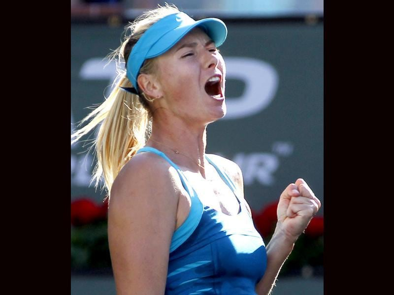 Maria Sharapova of Russia celebrates winning a game against compatriot Maria Kirilenko during their quarterfinal match at the Indian Wells WTA tennis tournament. Reuters/Danny Moloshok