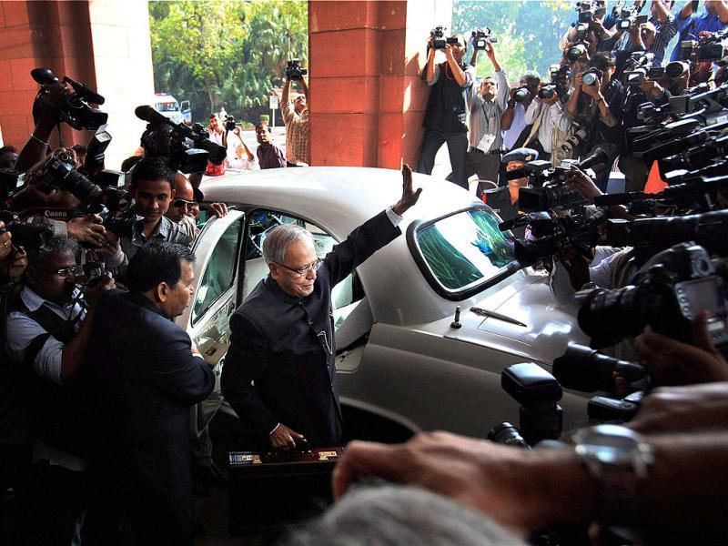 Union finance Minister Pranab Mukherjee arrives at Parliament to present the budget 2012-13, in New Delhi. PTI Photo by Shahbaz Khan