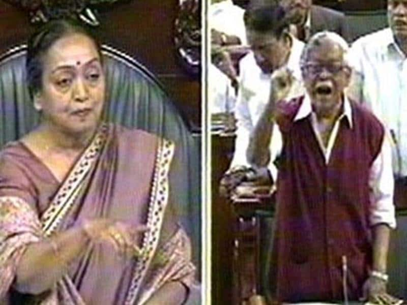 TV combo grab shows Union finance Minsiter Pranab Mukherjee presenting General Budget 2012-13, as Speaker Meira Kumar tries to quieten protesting members in Lok Sabha on Friday. Agencies.