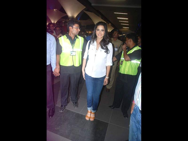 Sunny Leone looks happy as she lands in India.