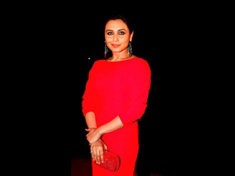 Rani Mukherjee in a red attire smiles for a pose. (AFP Photo)