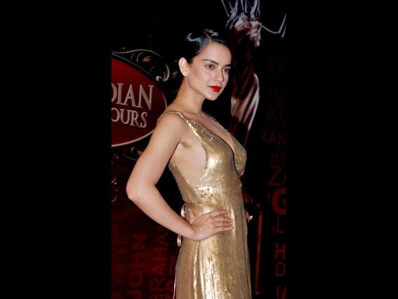 Kangana Ranaut looks hot as ever in a gold gown. (AFP Photo)