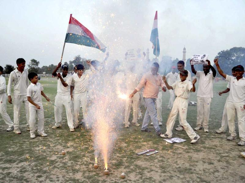 Young cricketers celebrate the 100th century of master blaster Sachin Tendulkar in Lucknow on Friday. PTI Photo