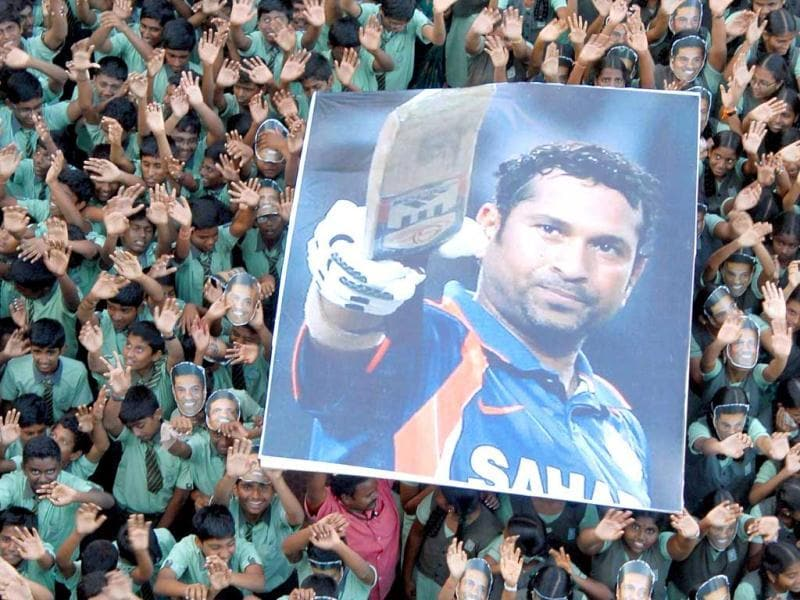 Students with a Sachin Tendulkar poster celebrating after he became the first cricketer to complete 100 International centuries during the Asia Cup One-dayer against Bangladesh. Agencies